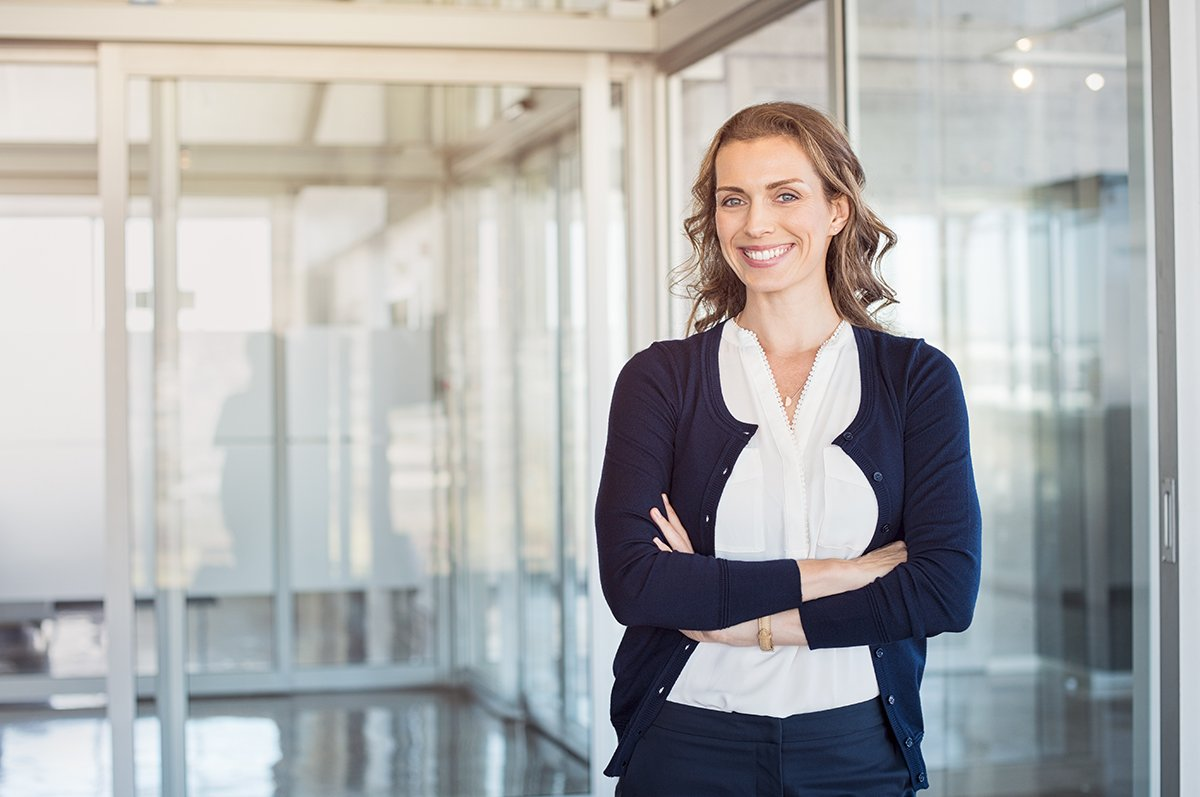 Being a Confident Managing Partner-Portrait of mature beautiful business woman in the office lookin