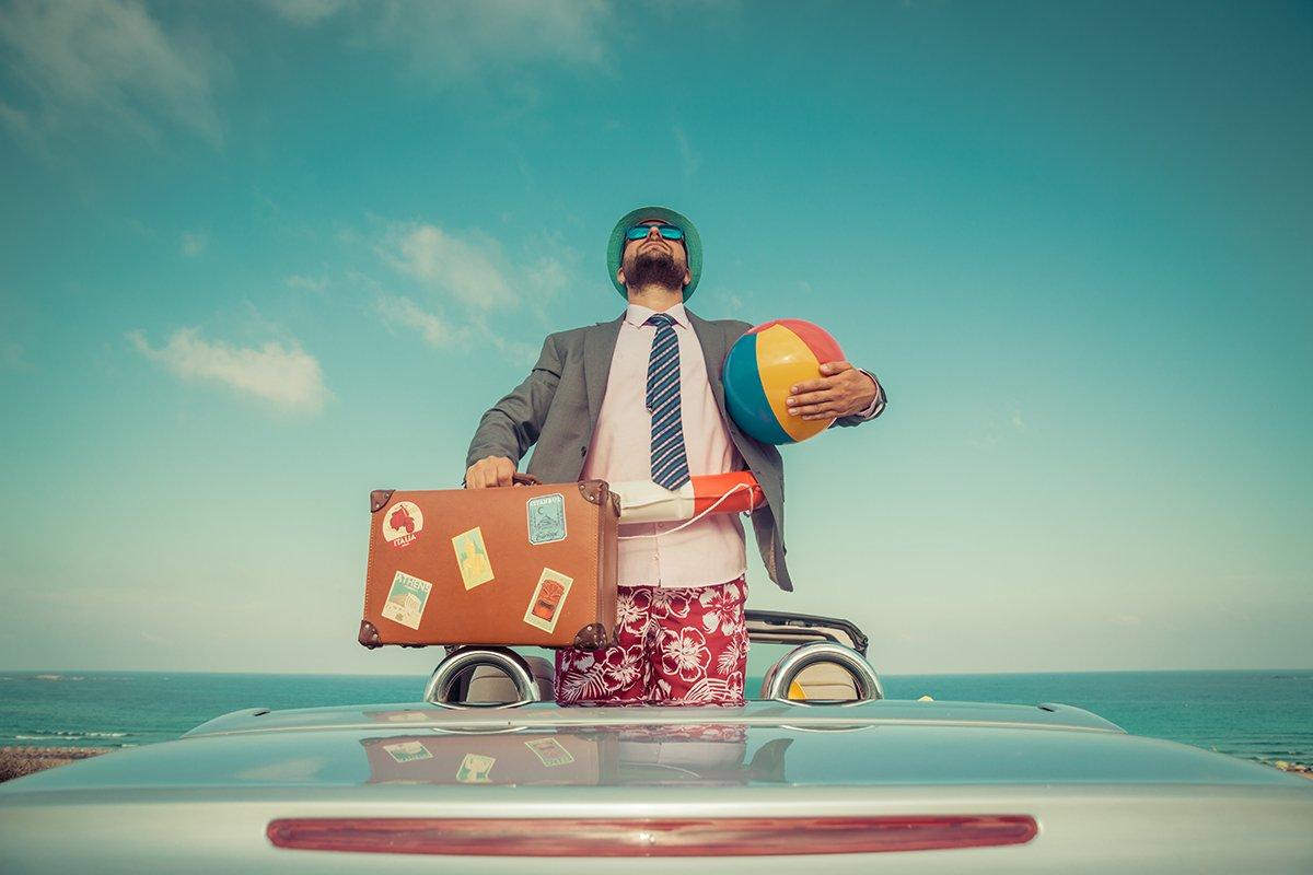 Striking a Balance-Businessman headed to the beach