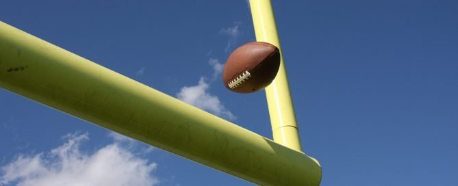 Between the Uprights-Goal-Football being kicked over the goal post