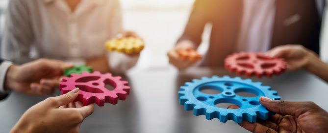 Culture-Business Team Connect Pieces Of Gears. Teamwork, Partnership And