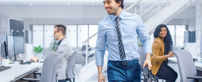 Confident businessman returning to the office